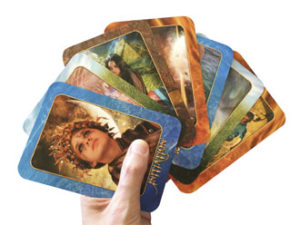 Hand holding transformation oracle divination cards